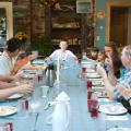 Family Gathered Around Farm Table_Hull-O Farms